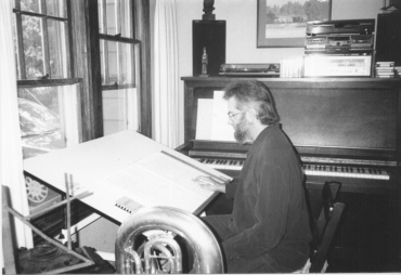 John Stevens writing with tuba and piano