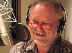 Bill McGlaughlin at  microphone