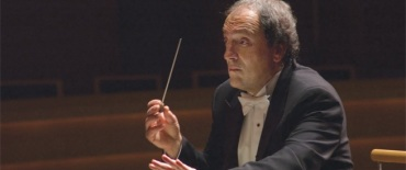 John DeMain conducting