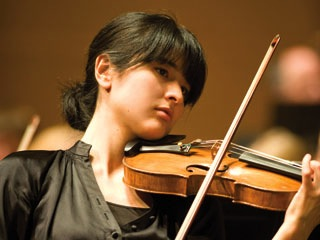 Naha Greenholtz [playing
