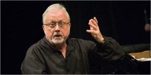 William Bolcom gesturing.