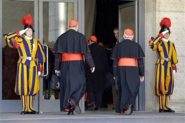 Vatican conclave with cardinals and Swiss Guard AP photo