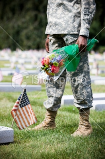army grave with flag and flowrds istock photo
