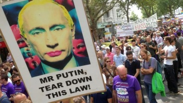 pro-gay march in russia with putin poster