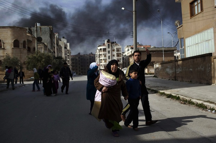 Syria family-escapes from-fierce fighting-between free-syrian army-fighters and-government-troops in idlib northern syria in march 2012