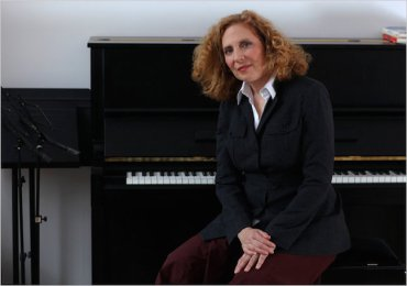 julia Wolfe with piano CR Richard Perry NYT