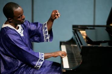 Nyaho at piano 1 Raised Hand