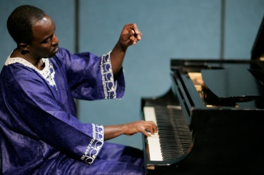 Nyaho at piano 1 Raised Hand