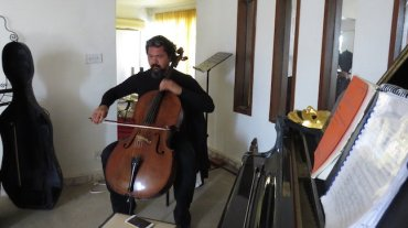 Cellist of Baghdad 3 at home