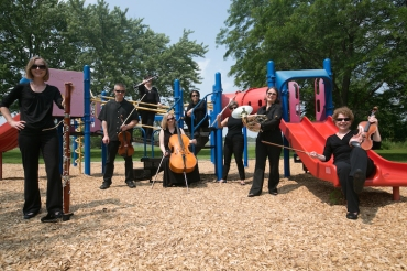 Oakwood Village Players on playground