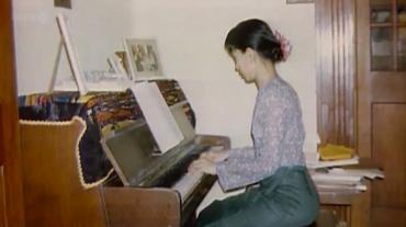 Aung San Suu Kyi playing piano