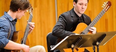 Undergraduates Erik Anderson, left, and Anthony Caulkins perform a duet during a UW Guitar Ensemble music concert in Mills Hall at the Mosse Humanities Building at the University of Wisconsin-Madison during spring on April 17, 2013. The photograph was created for #UWRightNow, a 24-hour multimedia and social-network project. (Photo by Jeff Miller/UW-Madison)
