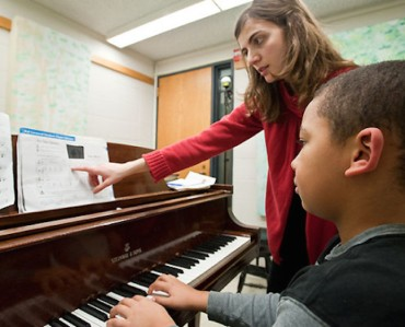 Piano Pioneers program coordinator and instructor Paola Savvidou (left) works with student Jacob Horton (right) during a piano lesson inside the Mosse Humanities Building at the University of Wisconsin-Madison on Jan. 26, 2009. Piano Pioneers is a UW-Madison School of Music community outreach program that offers scholarship lessons to children and adults in the Madison community who would like to study the piano but can't afford the full cost of lessons. ©UW-Madison University Communications 608/262-0067 Photo by: Bryce Richter Date: 01/09 File#: NIKON D3 digital frame
